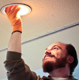 Man screwing in an LED light bulb
