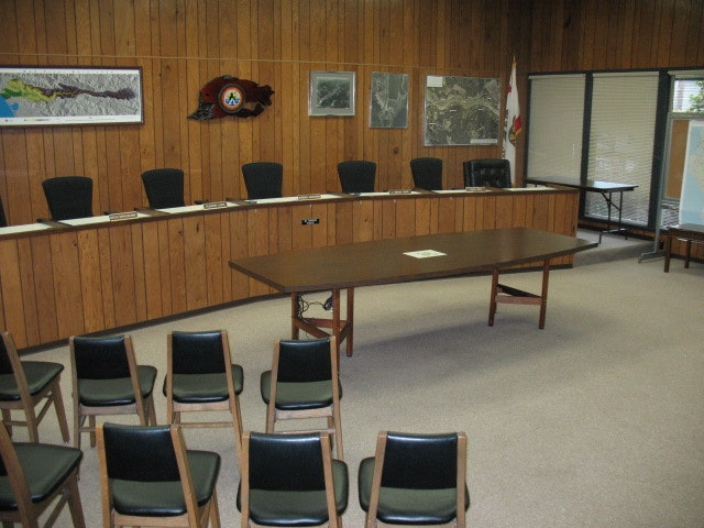 Meeting room at Humboldt Bay Municiple Water District office showing empty board member chairs and audiance chairs