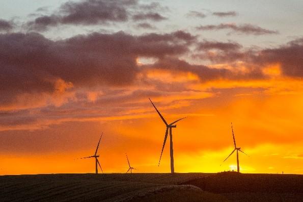 Onshore wind turbines at sunset