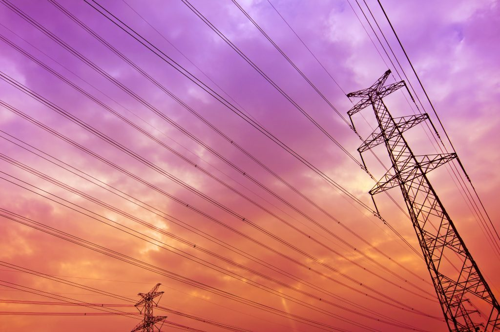 power lines with colorful sky