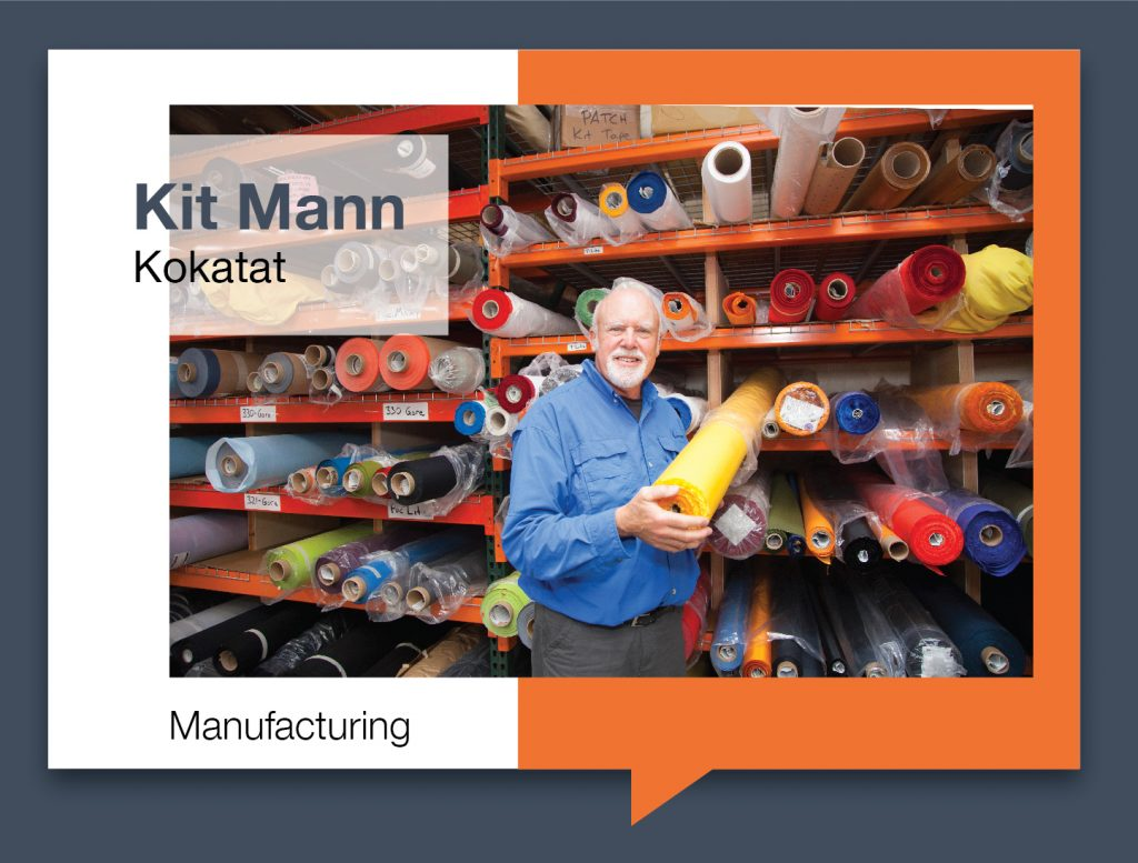 Kit Mann next to shelf of fabric inside Kokatat