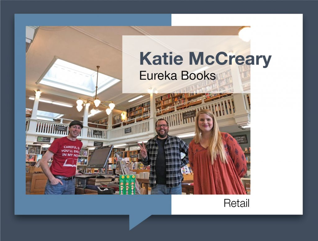 Katie McCreary and coworkers standing inside Eureka Books