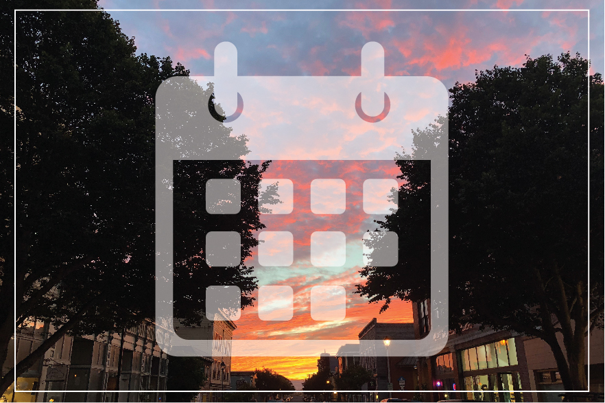 calendar logo in front of buildings at sunset