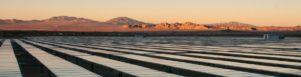 Solar panels next to a desert sky