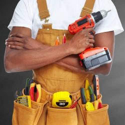African american Worker man with a drill.